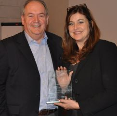 Global Reach Network Chairman Robin Baker hands the Chairman's Award 2013 to Valerie Harding, Ripple Effect Communications